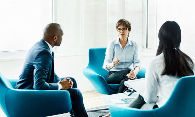 wealth manager in meeting with a client